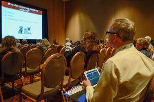 WVC attendee using eventScribe's Audience Response System by CadmiumCD.
