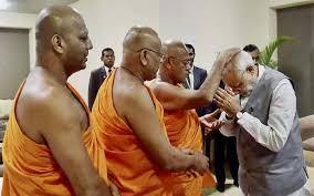 Modi with Mahavamsa Sri Lankan Sinhala Buddhist priests who  preach the killing of Tamils and Hindus is acceptable