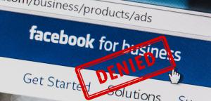 "A ""Denied"" ruling is stamped on an image of a Facebook ad solicitation page"