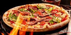 Want to impress your family and friends by cooking a pizza directly on your BBQ grill?